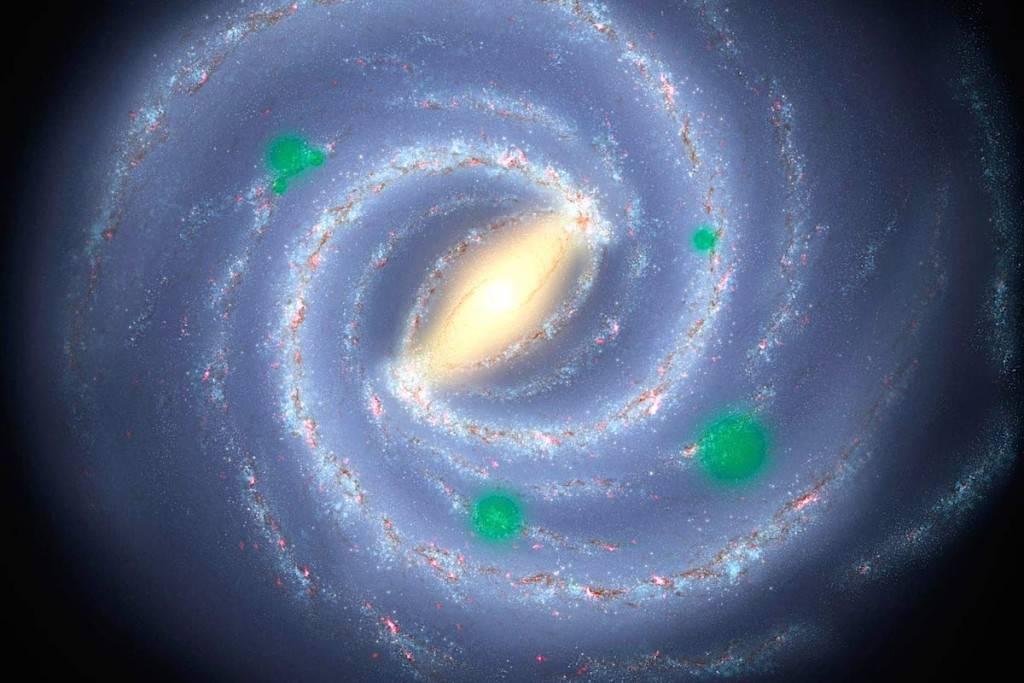 Conceito artístico da Via Láctea. Assinaladas a verde, as regiões onde a vida alienígena pode ter se espalhado além de seu sistema para criar oasis de vida - a chamada panspermia