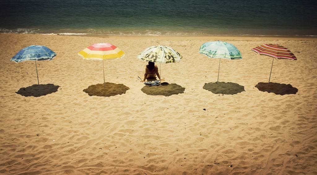 A praia, o sol e as férias
